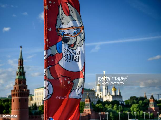 A photograph taken on May 30 2018 shows the FIFA World Cup 2018 flag featuring the tournament's mascot Zabivaka in front of the Kremlin in Moscow The...