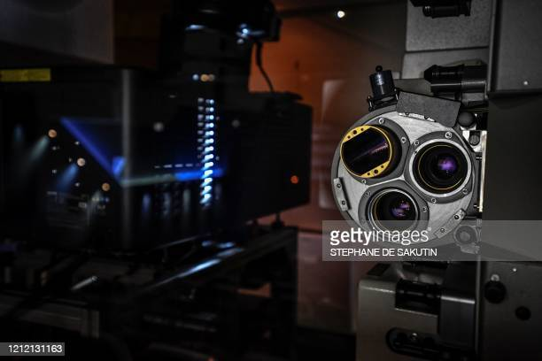 A photograph taken on May 7 2020 shows the a 35mm cinema projector at the movie theatre Cinema Majestic in Paris as the country is under a strict...