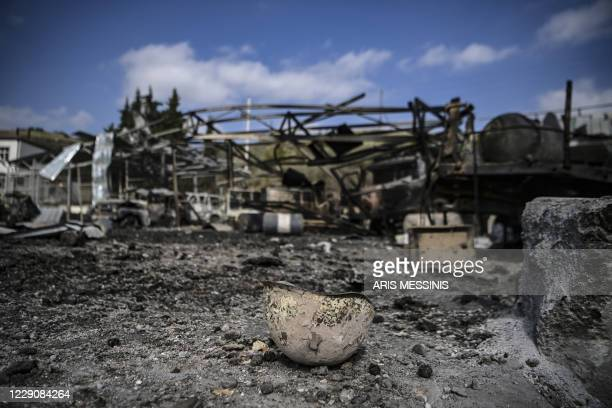 Photograph taken on October 15, 2020 shows a destroyed and burnt helmet lying on the ground of the hospital of Martakert region, a day after shelling...