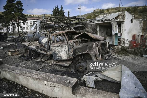 Photograph taken on October 15, 2020 shows destroyed vehicles and facilities of the hospital of Martakert region, a day after shelling during the...