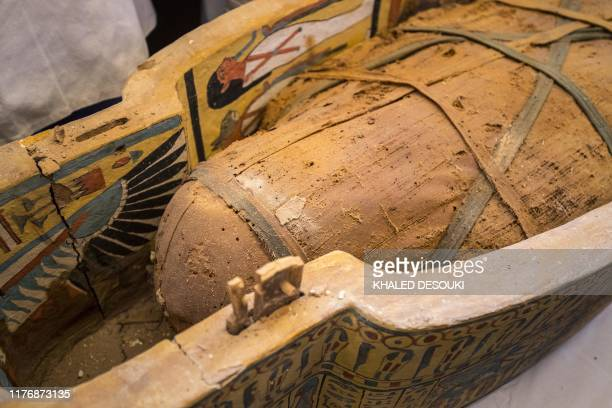A photograph taken on October 19 2019 shows a detail of an open sarchophagus displayed in front of Hatshepsut Temple in Egypt's valley of the Kings...