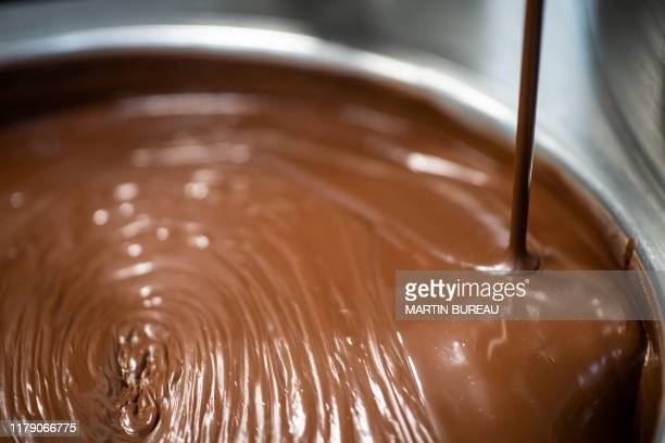 Photograph taken on October 30 shows chocolate melted at the factory of the French chocolate sculptor Patrick Roger in Sceaux.