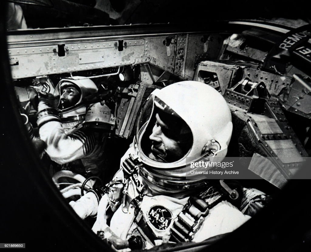 Photograph taken within Gemini 5 of Astronaunts L. Gordon Cooper Jr., command pilot, and Charles Conrad Jr. Dated 20th century.