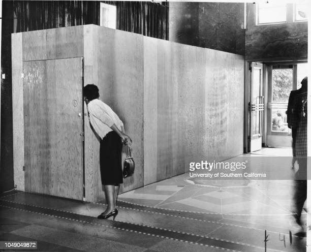 Photograph 'Velva Whitfield sneaks a peek What's in the box' 'Electronic 'mail man' tested Wire May Flash Letters East The day is not far distant...