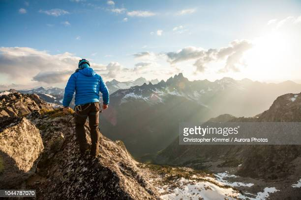 photograph with rear view of mountain climber in north cascade mountain range, chilliwack, british columbia, canada - カスケード山脈 ストックフォトと画像