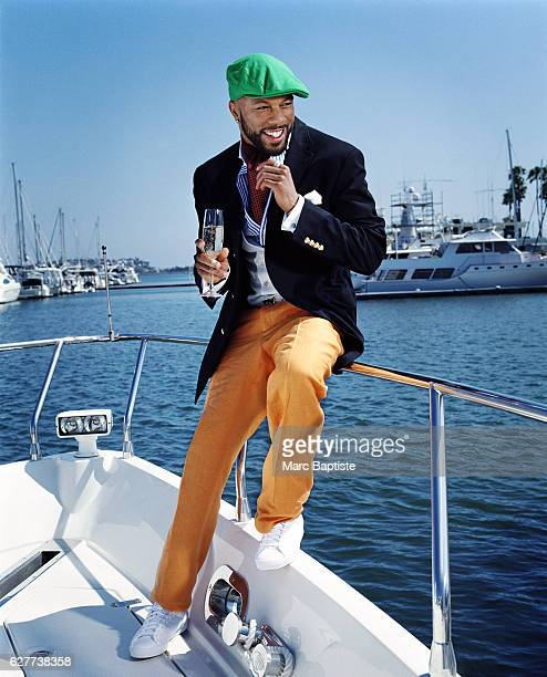 Photographed aboard a Maverick III in Marina del Rey, California. Jacket, shirt, pants, ascot and belt by Ralph Lauren, pocket square Dominico Vacca,...