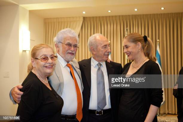 Photographed at the home of the president of Israel Shimon Peres with Anat Atzmon her father Shmolik Atzmon and motherThis was a conference talking...