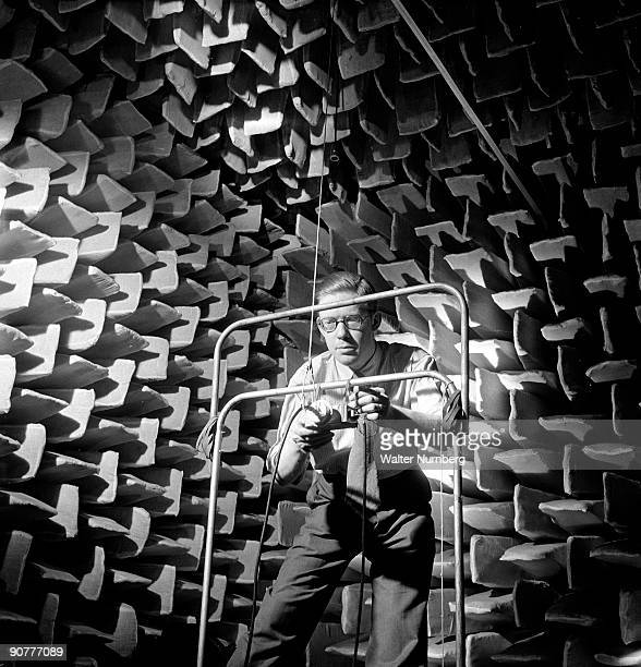 Photographed at the Wembley acoustic research laboratories of GEC the General Electric Company a sound engineer prepares a rig to test sound...