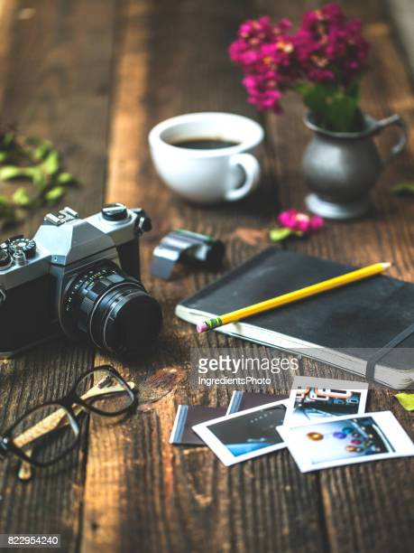 Photographer accessories on the table conceptual photography background.