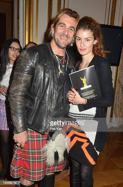 Photographer Alexandre Ale de Basseville and Julia Alethea Gagyi editor from 'Le Mag' magazine attend the 'Trophee Paris Cinema Awards' Press...