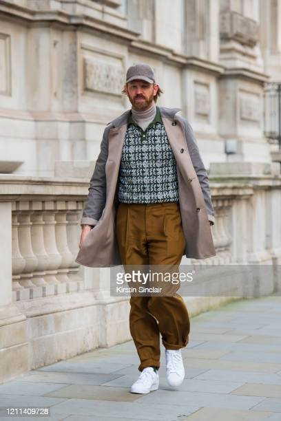 Photographer Alistair Guy wears a Dak's polo shirt E Tautz trousers Hackett roll neck sweater Adidas trainers Lock and Co hat and a Johnstons of...