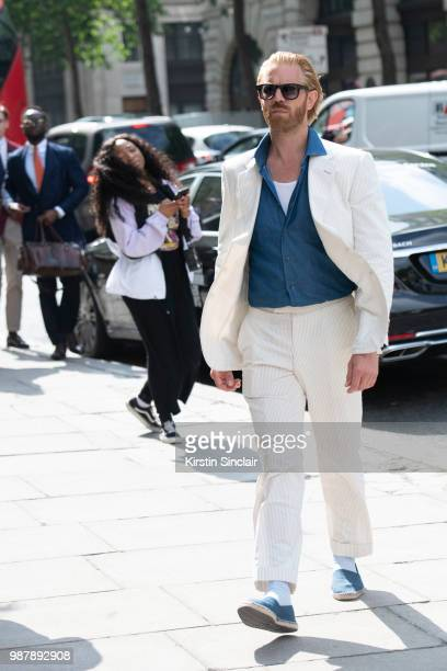 Photographer Alistair Guy wears an English Cut suit Celine sunglasses Replay shoes and Tommy Hilfiger shirt London Fashion Week Men's on June 10 2018...