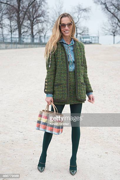 Photographer and Artist Micol Sabbadini wears a Ralph Lauren shirt Vintage Chanel suit Ray Ban sunglasses Manolo Blahnik shoes and Fendi bag on day 8...