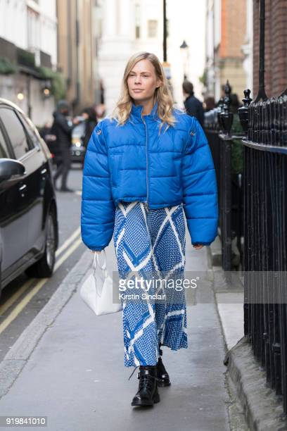 Photographer and fashion influencer Jessie Bush wears an MSGM skirt Phillip Lim Puffer jacket Emma Charles bag and Louis Vuitton boots on day one of...
