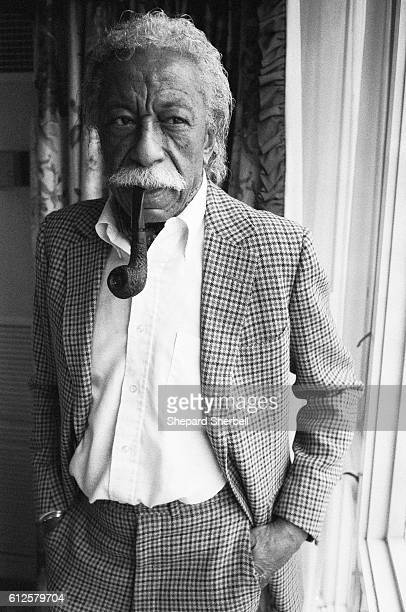 Photographer and film director Gordon Parks smokes a pipe at the RitzCarlton Hotel in Boston