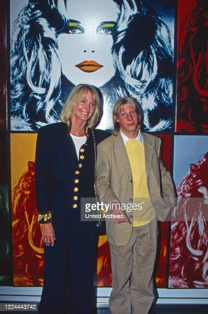 Photographer and fine arts collector Gunter Sachs's wife Mirja and son Claus Alexander at an exhibition of Gunter's artwork Germany 1991