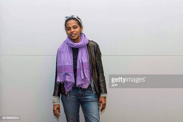 Photographer and founder of the Addis Foto Fest Aida Muluneh poses on December 14 2016 ahead of the opening of the biannual photography festival in...