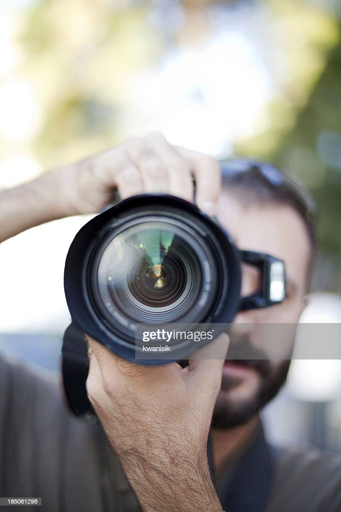 photographer and lens close up : Stock Photo