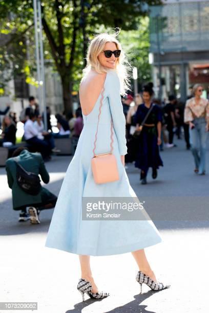 Photographer and Model Candice Lake wears an Emilia Wickstead dress Balenciaga shoes Peter Pilotto earrings Roksanda Ilinicic bag and Victoria...