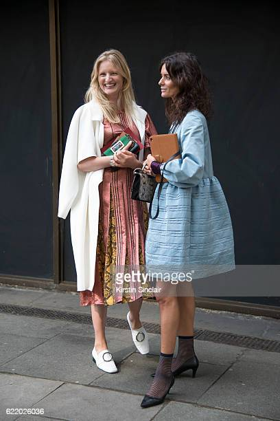 Photographer and Model Candice Lake wears Dorateymur shoes Christopher Esper jacket Burberry dress and bag with Fashion blogger Hedvig Opshaug...