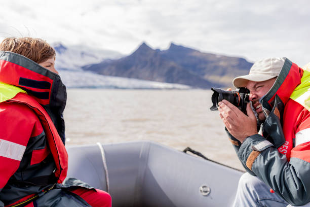 photographer and model on a boat in Jökulsárlón lagoon