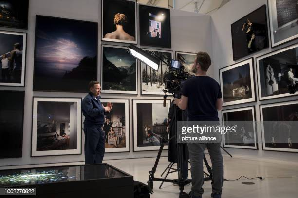 Photographer Andreas Muehe gives an interview at the Deichtorhallen in Hamburg Germany 18 May 2017 The Haus der Photographie at the Deichtorhallen is...