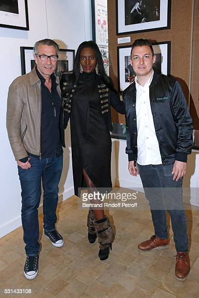 Photographer Andreas Neumann his wife Khadija and photographer Matt Helders attend Iggy Pop 'Post Depression' Art Pictures Exhibition at French Paper...