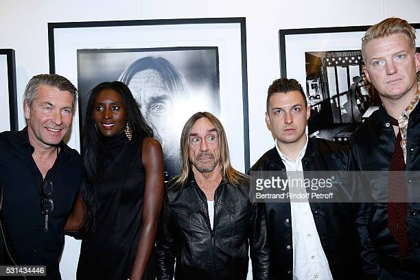 Photographer Andreas Neumann his wife model Khadija Neumann singer Iggy Pop photographer Matt Helders and musician Josh Homme attend Iggy Pop 'Post...