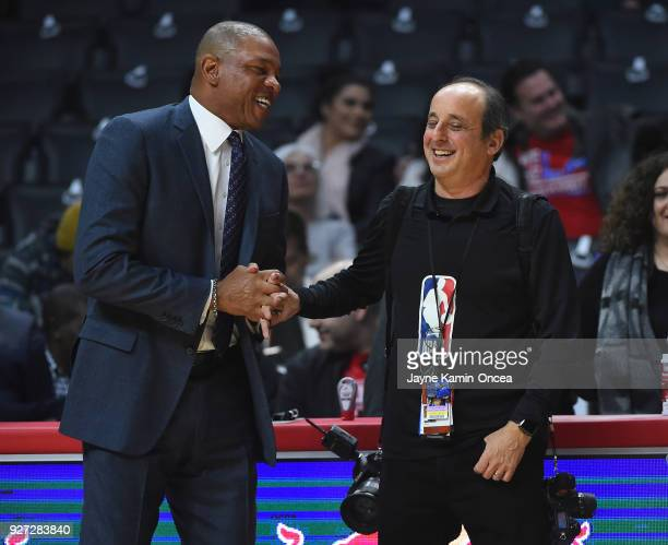 NBA photographer Andy Bernstein talks with head coach Doc Rivers of the Los Angeles Clippers before the game against the New York Knicks at Staples...
