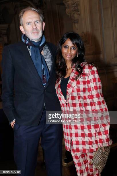 Photographer Anton Corbijn and Mimi Ponnudurai attend the Berluti Menswear Fall/Winter 20192020 show as part of Paris Fashion Week on January 18 2019...