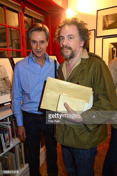 Photographer Aramy Machry and writer Simon Liberati attend 'Les Racines De La Ville' Aramy Machry' s Photo Exhibition Preview At 'Le Plac Art'...