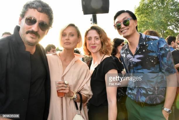 Photographer Arno Bani model Iguana Butane a Guest from BHV Marais and PR /designer Axel Huyhn attend 'Ibiza Boheme' Launch Party By BHV Marais on...