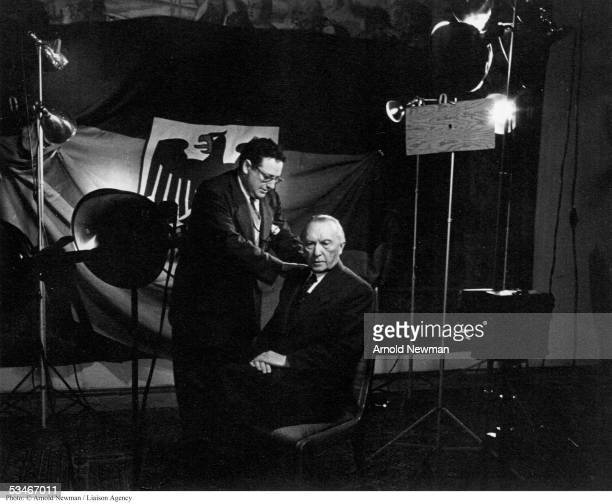 Photographer Arnold Newman prepares to photograph Konrad Adenauer first Federal Chancellor of West Germany leader of the Christian Democratic Union...