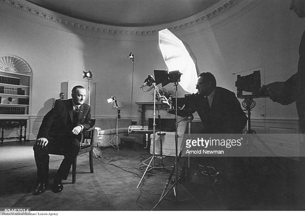 Photographer Arnold Newman takes a picture of President Lyndon B Johnson in the Oval Office December 19 1963 in Washington DC