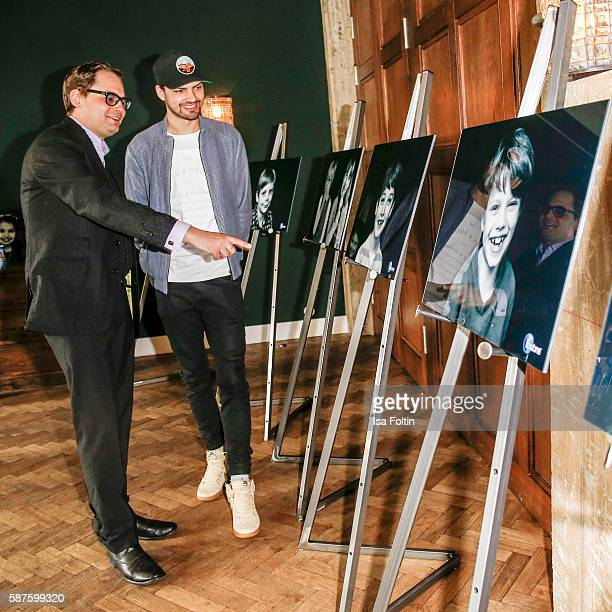 Photographer artist and performer Peter Badge and german actor Jimi Blue Ochsenknecht attend the photo exhibition 'Die Kunst des Kinderlaechelns' by...
