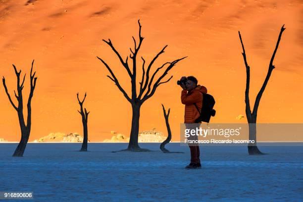 Photographer at Dead Vlei, Namib desert