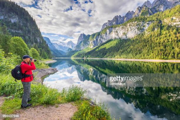 photographer at gosausee with dachstein view - european alps - upper austria stock pictures, royalty-free photos & images