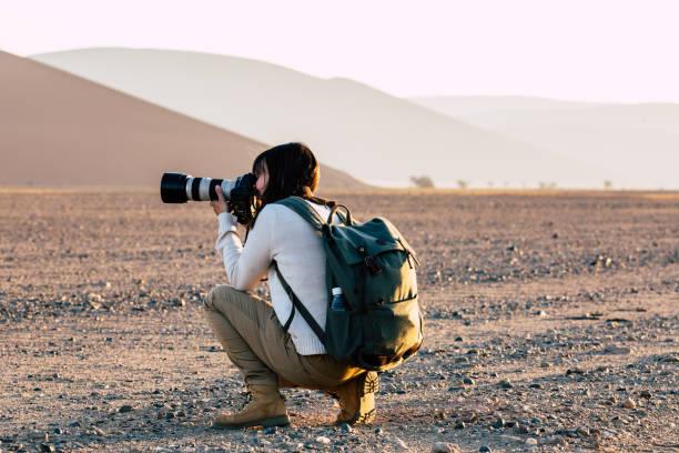 photographer at namib desert picture id916880954?k=20&m=916880954&s=612x612&w=0&h=ePGYmqUCD PqPwvGVGmLGk39W3V r8mPUAFdMMAFnA=