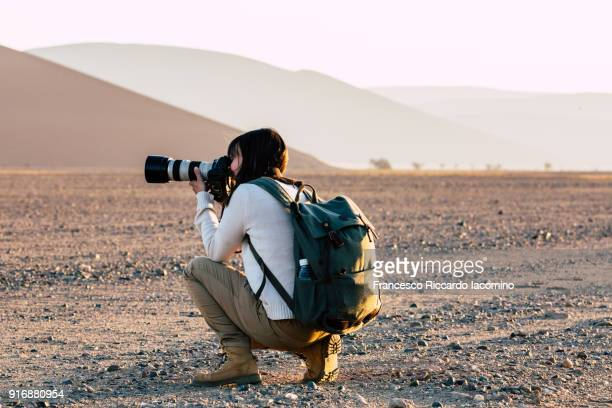 photographer at namib desert - photographer stock photos and pictures
