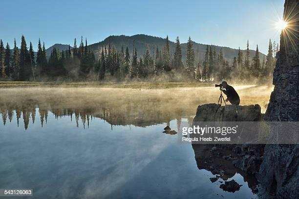 Photographer at sunrise at Sparks Lake, Central Oregon, USA