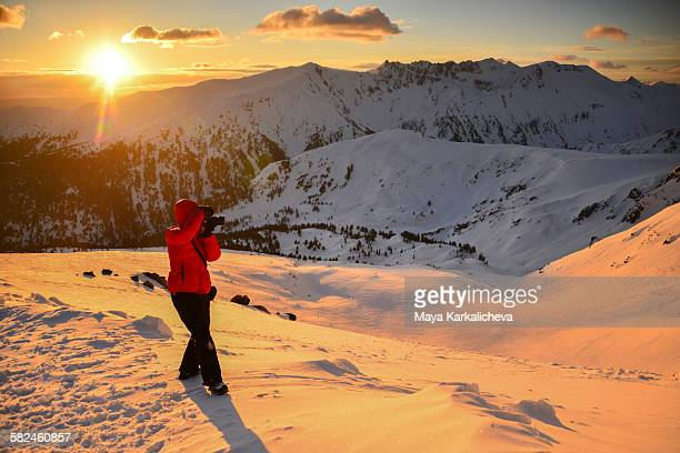 photographer at sunrise in a snowy mountain - pirin national park stock pictures, royalty-free photos & images