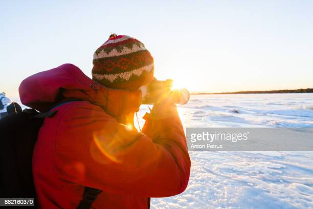 Photographer at sunset in winter