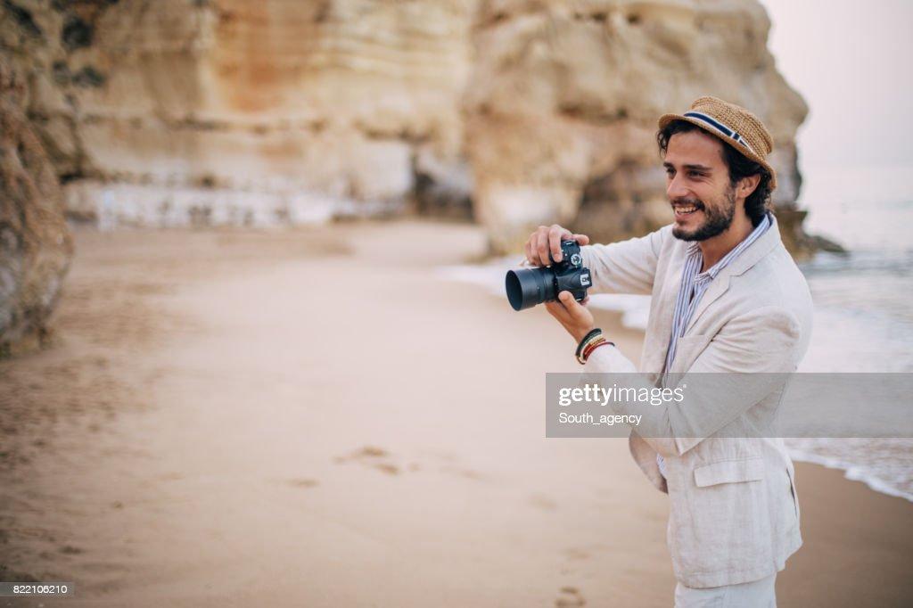 Photographer at the beach : Stock Photo