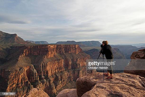 Photographer at the Grand Canyon, Toroweap Point, Tuweep Area, North Rim, Arizona, USA