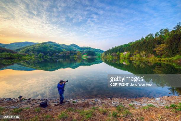 A photographer at the lake with Springtime colors