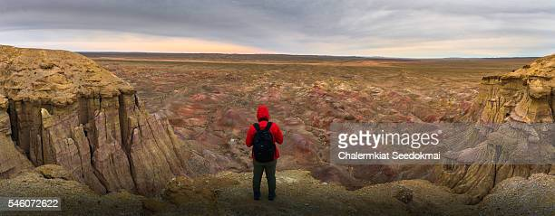 Photographer at the rocky formations of Tsagaan Suvarga, Mongolia