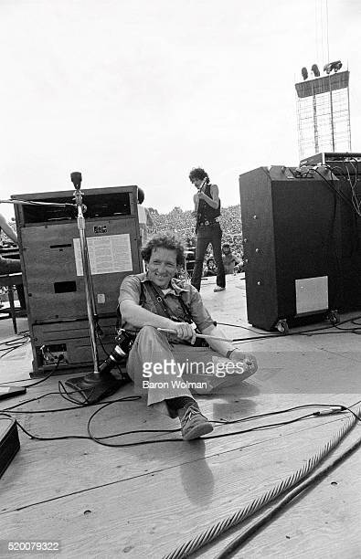 Photographer Baron Wolman is photographed by Bill Graham during the Woodstock Festival Bethel NY August 1969