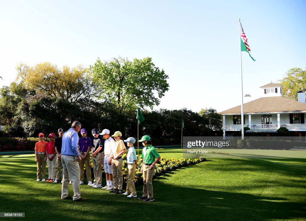 Photographer Barry Koenig poses competitors for an official photos during the Drive, Chip and Putt Championship at Augusta National Golf Club on April 2, 2017 in Augusta, Georgia.