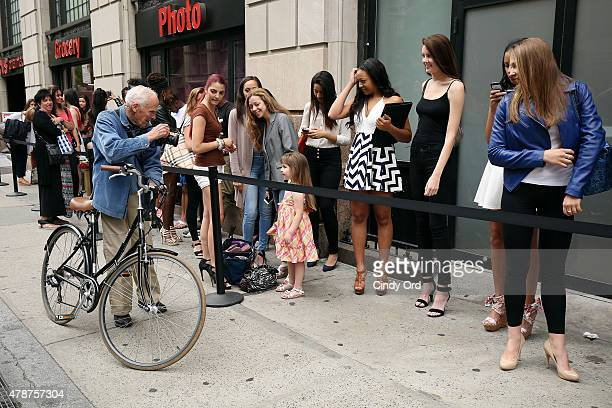 Photographer Bill Cunningham photographs model contestants outside the European Wax Center and Wilhelmina Summer Goddess Model Search New York Open...
