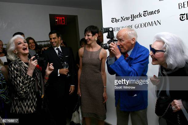 Photographer Bill Cunningham takes a picture during celebration for his career at Bergdorf Goodman on September 10 2008 in New York City